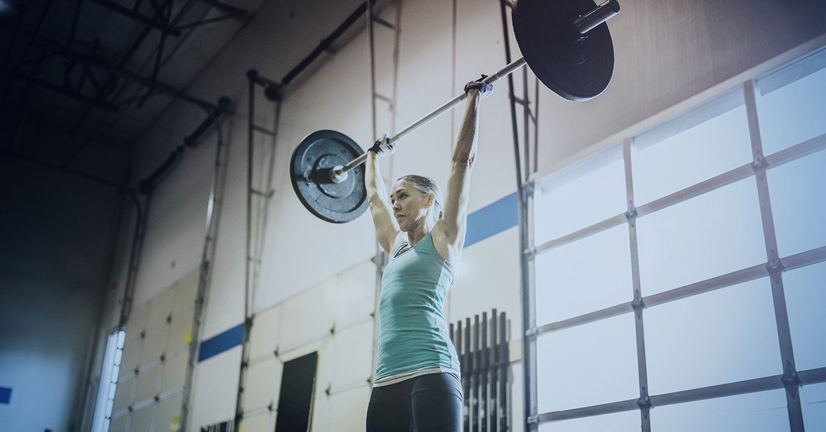 Woman weightlifting with barbell