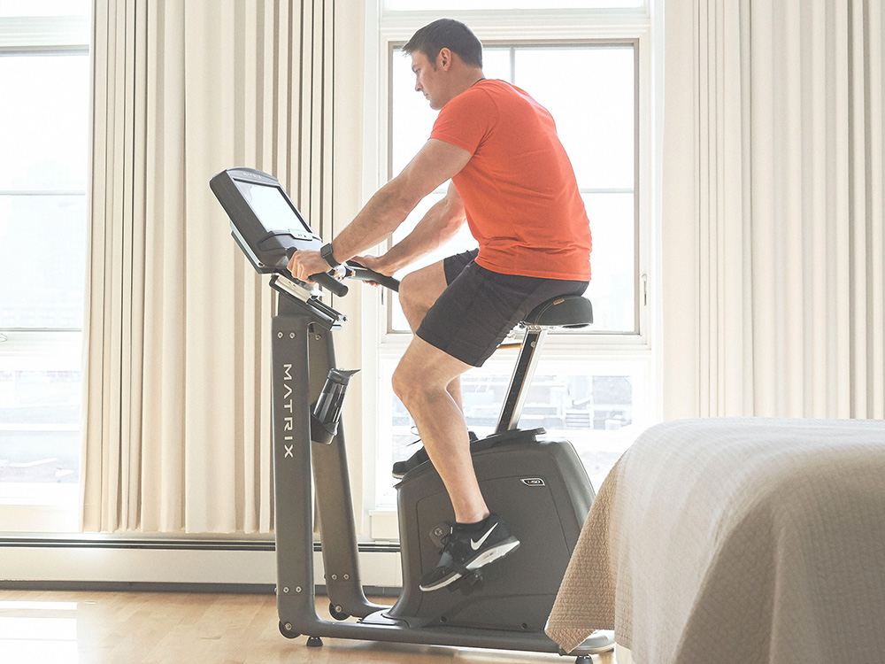 Man on Upright Exercise Bike doing a HIIT exercise bike workout